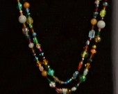 Multicolored stones with a sterling silver cross pendant