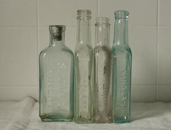 Four Antique Apothecary Bottles
