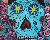 Day Of The Dead skull in turquoise and shades of pink mixed media