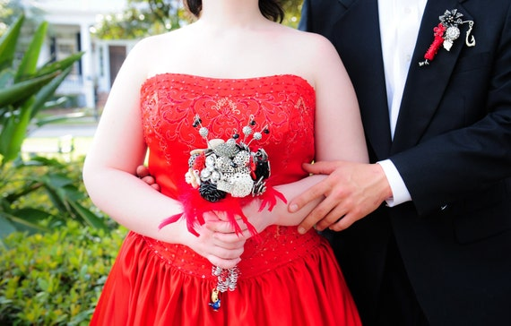 Black and white and red jeweled wedding bouquet and matching boutonniere