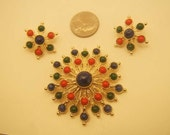 Sarah Coventry - gold tone, red, green, and blue brooch and clip on earring set