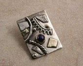 Sterling Silver, Gold, and Lapis Pendant