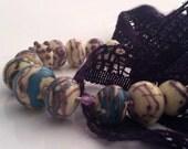 Destash - Purple Bargain Lot of Seconds/Orphan beads (12) SRA