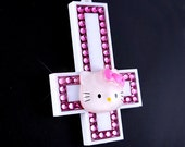 Hello Kitty Inverted Cross necklace.