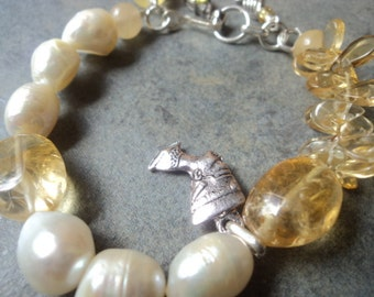Citrine, fresh water pearl and sterling silver bracelet.