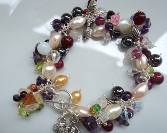 Mixed-gemstone, fresh water pearl silver charm bracelet.
