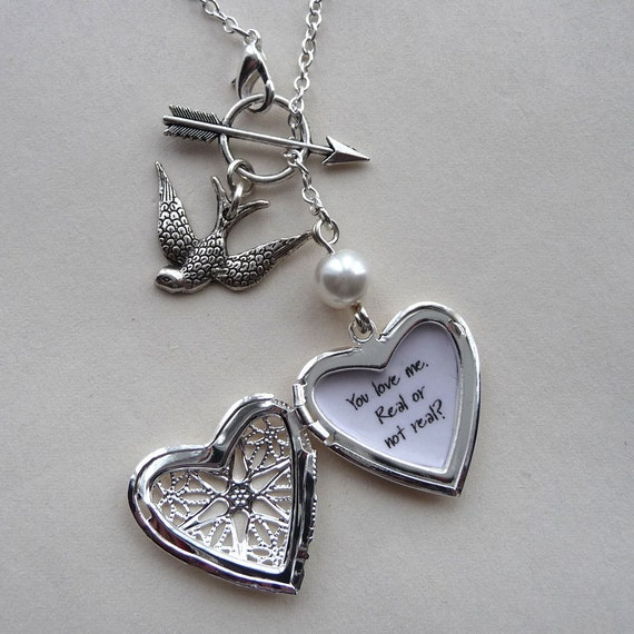 Hunger games inspired heart locket arrow pearl You love me. Real or not real