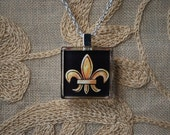 Elegant gold and black Fleur De Lis glass pendant