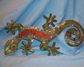 Mosaic glass covered lizard.