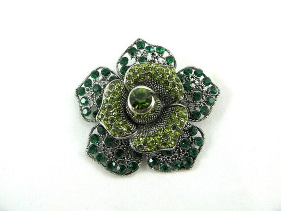 Green brooch with Swarovski Crystals.