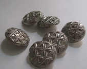 6 large silver tone embossed buttons
