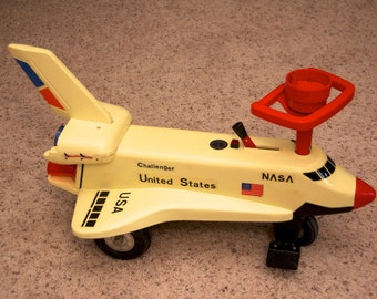 Vintage motorized ride-on NASA Space Shuttle Challenger toy