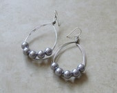Silver pearls on silver wire hoops