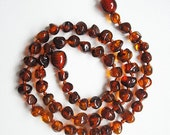Warm Honey Rounded  beads Baltic Amber teething necklace for your baby handmade knotted .
