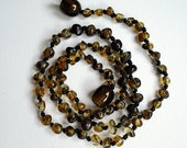 Green Greenish rounded   Natural  Baltic Amber Teething Necklace.  Handmade knotted.