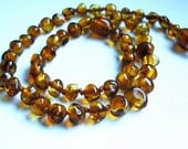 Cognac  Baroque shaped  beads. Natural  Baltic Amber Baby  Teething Necklace w Remedy effect.