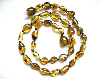 Baltic Amber baby teething necklace  handmade knotted .High quality. New style.
