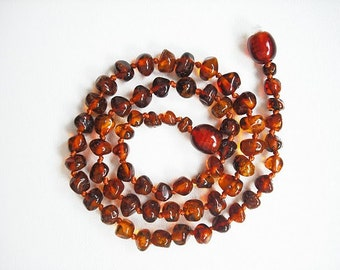 Baltic Amber  Baby Teething necklace . Cognac colour beads.
