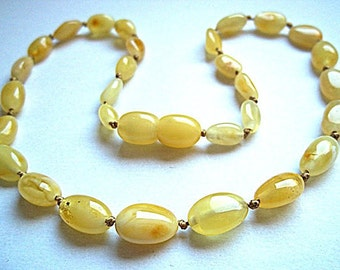 Baltic Amber Baby Teething Necklace. Olive shaped  white beads..