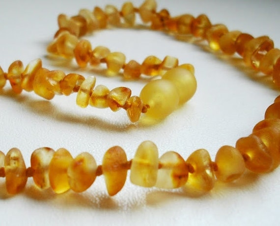 Unpolished roundish Honey color Baltic Amber Baby  Teething Necklace.  Maximum pain relief.