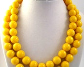 Bright yellow double strand bubble gum bead necklace.