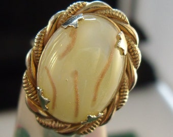 Yellow and gold confetti glass ring.