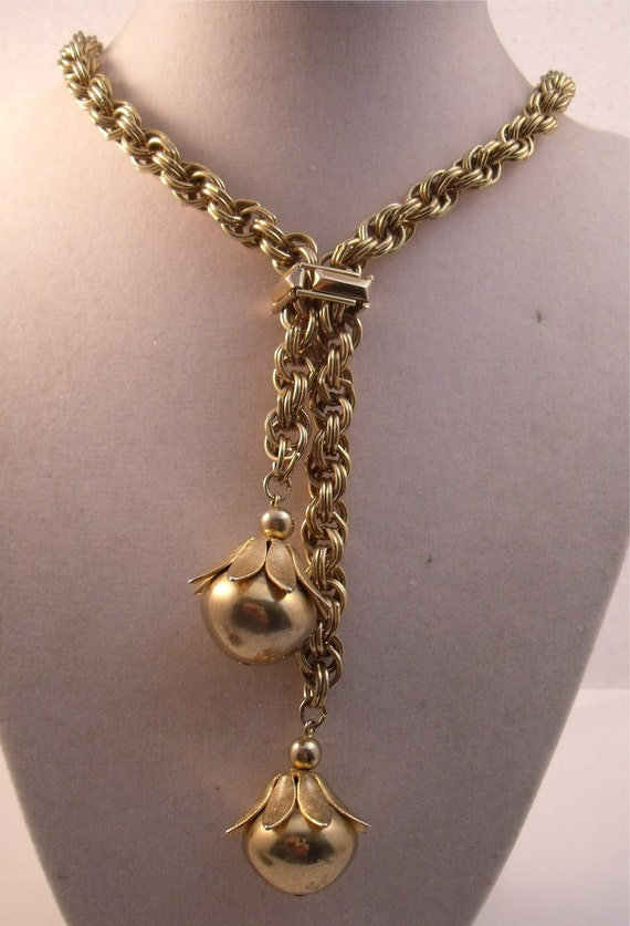 Heavygold tone chain with double ball pendant and movable toggle