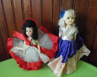 Vintage Hard Plastic Dolls Jointed Head and Arms Sleepy Eyes Clothes Stapled In Place