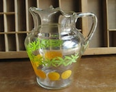 Glass Juice Pitcher with Oranges and Green Leaves