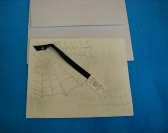 Hand stamped Spider Web Halloween card with spider on black ribbon
