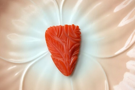 Bakelite Deeply Carved Dress Clip Salmon Color