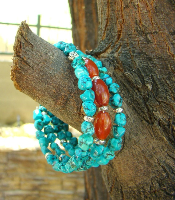 Sky Circles: Turquoise nugget bracelet with red agate focal beads and sterling silver on memory wire