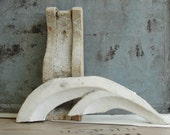 Architectural salvage wood corbel and flourish white chipped paint in solid wood industrial decor
