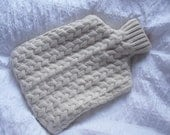 Cream Hot water bottle cover in 100% pure wool recycled from sweater . Beautiful cabling with bottle