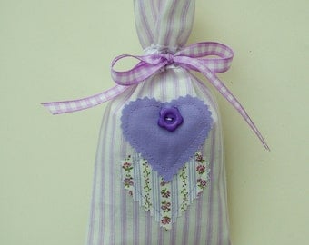 Lavender scented bag in striped fabric with heart and button decoration.