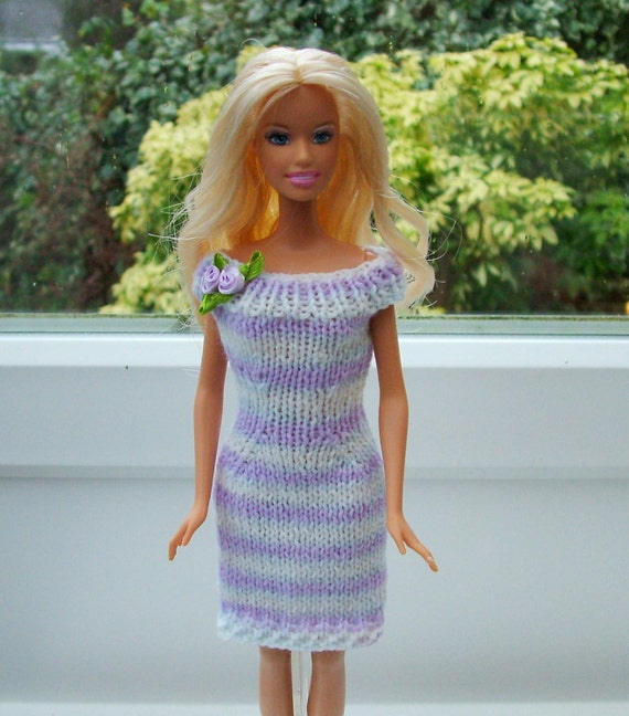 Order for Leslie only. Lavendar and white knitted dress to fit Barbie type dolls.