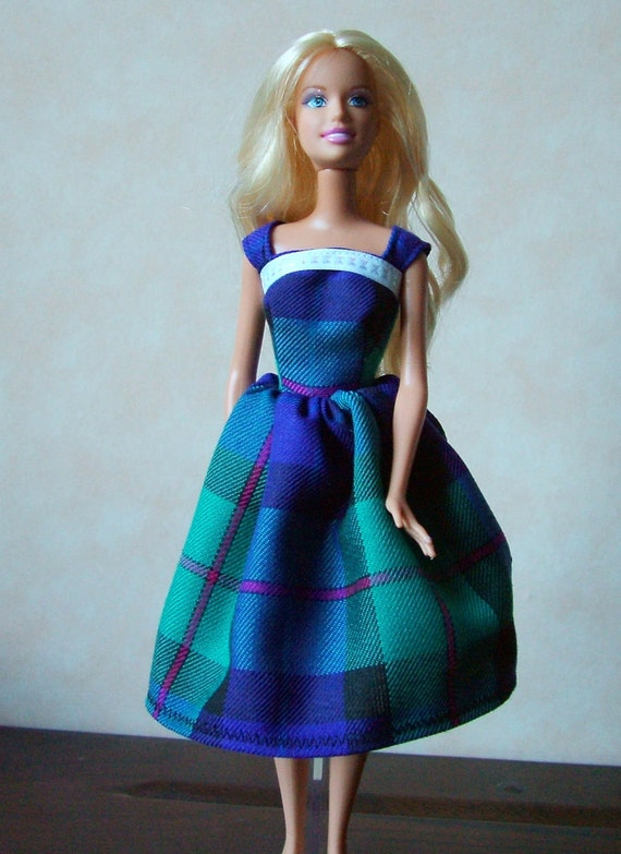 Doll clothes handmade to fit Barbie size dolls. Purple and green tartan dress to fit Barbie type doll.