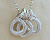 Rings Necklace. Hammered Sterling Silver Circles. Necklace with Round Organic Loops
