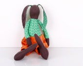 African Dark brown parties rabbit   Wearing a shirt with green dots And orange corduroy pants  -handmade fabric doll