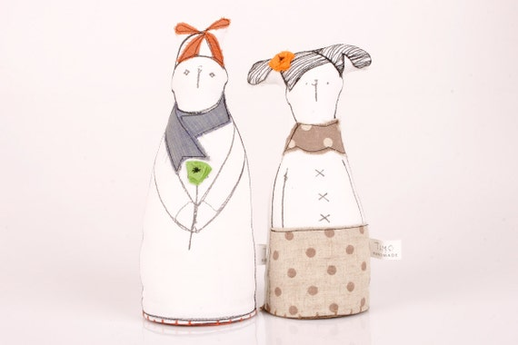 Boy and girl - He in a hat and scarf holding a flower and she's wearing a brown polka-dot skirt - handmade fabric dolls