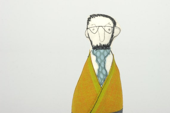 Man - a guy with glasses And beard wearing  Yellow mustard jacket gray striped pants and dotted turquoise tie  - handmade