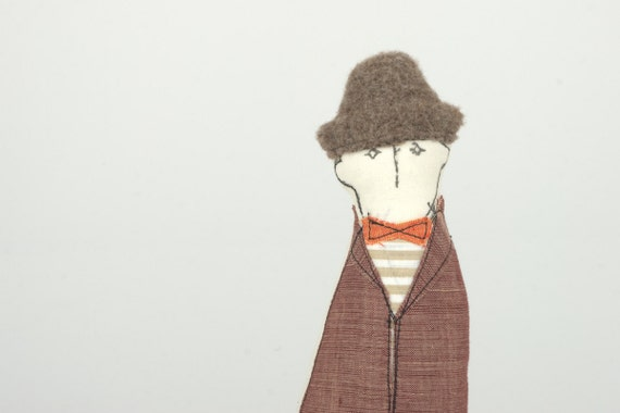 Father, brother, friendor neighbor, you sure know that Family guy -in Beige hat And orange Papillon Jacket and pants handmade doll