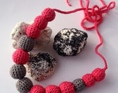 Tangerine and gray effect necklace of crocheted beads