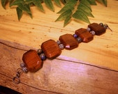 Bracelet with hand carved wooden tiles, silver and blue beads