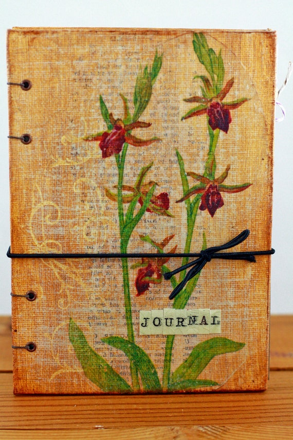 mixed media journal, coptic stitched, vintage images and papers used