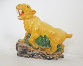 Vintage Saber Tooth Tiger Plastic Figurine Bank Toy 1987 Small World Importing Made in Taiwan Ice Age Yellow Green Brown