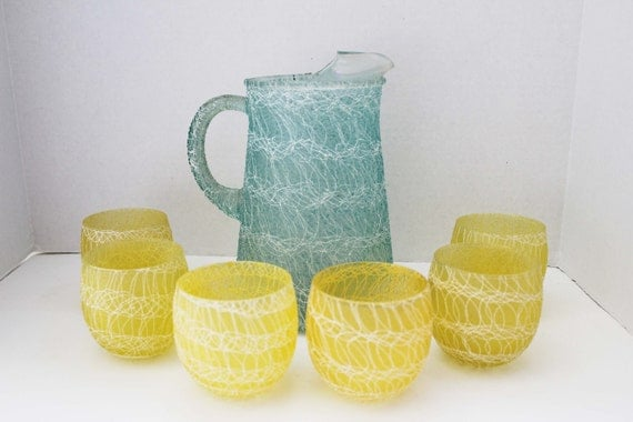 Spaghetti Drizzle Pitcher and Roly Poly Rubberized Glass Set with Six Yellow Glasses and One Green Pitcher