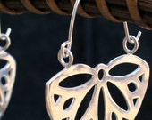 Silver hoop earrings flower shaped, Flower Hoops, Daisy silver earrings