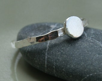 Silver ring with a small silver pebble