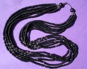 VINTAGE: Black wood necklace with 6 chains & silver beads from the early 80's.